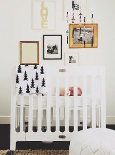a white nursery theme with unique wall decor