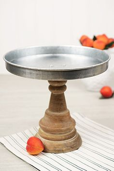 "21.00 SALE PRICE! 		This 8-1/4"" tall pedestal stand has a metal tray that is 9-1/4"" wide. The sides are 1"" deep. It is perfect for serving and..."