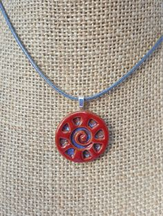 Check out this item in my Etsy shop https://www.etsy.com/listing/460106298/ceramic-pendant-red-and-blue