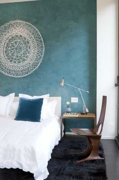 The Venetian plaster walls in this room further accentuate the textures of the rugs and pillows. For an easy wall design try Anvil's Venetian Plaster tinted to your favorite shade. www.anvilpaints.com #AnvilPaints #VenetianPlaster