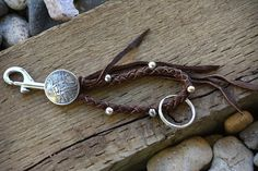 Hey, I found this really awesome Etsy listing at https://www.etsy.com/listing/169321746/braided-brown-leather-beaded-key-chain