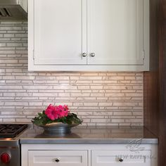 This custom kitchen features a handmade Bamboo mosaic backsplash shown in Bardiglio and Calacatta Tia from New Ravenna.<br /> <br /> For pricing samples and design help, click here: http://www.newravenna.com/showrooms/