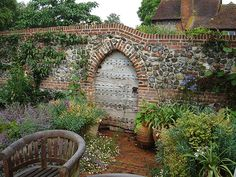 old oak door flint wall is part of Brick garden Wall - Lancet head doorway in a flint and brick garden wall Brick Wall Gardens, Brick Garden, Garden Entrance, Garden Gates, Garden Wall Designs, Garden Design, Brick Archway, Country Cottage Garden, Brick And Stone