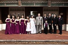 Our bridal party. All of the guys wore black suits and sangria purple ties and vests. The girls all picked out their own sangria dress from David's Bridal. The only rule I had was that the bridesmaid dresses had to be long and sangria colored. Everybody looked amazing!