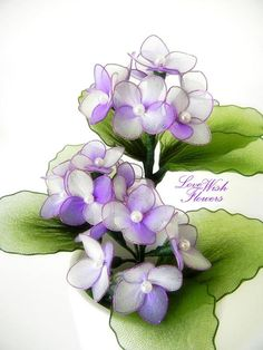 Charming purple hydrangea is a spring flower. Handcraft nylon fabric flower and leaves. Bouquet dimensions approximate: 9 inches(w) x 5 inches(d) x 10.5 inches(h) flowerpot included at shipping package. Note:* As light shooting and computer monitor, maybe the color has a little