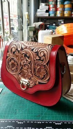 Tooled leather bag. I'll take one please.
