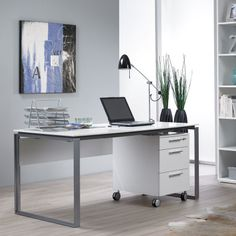 The Perfecta Desk epitomizes the Scandinavian design tradition with a focus on simple, minimalist lines. Attractive, open end panels are crafted of sturdy, welded steel, and powder-coated in a rich, dark silver finish. Top and modesty panel are available in anthracite or white. $499 - $529 Office Furniture, Office Decor, Home Office, White Desks, Modern Desk, Large White, Contemporary Furniture, Scandinavian Design, Powder