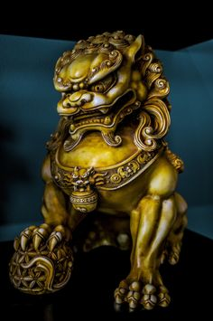 Shishi  is the Chinese word for guardian lions which are statues believed to have mythical protective powers.  My brother has a pair of these in his tattoo shop.