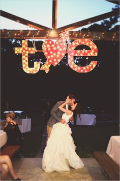 Love these marquee lights to light up a dim reception dance floor.  Captured By: Sarah Murray Photography ---> http://www.weddingchicks.com/2014/05/13/quirky-budget-friendly-wedding/