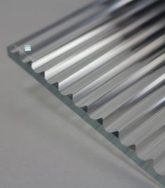 Deep V groove lines carved on low iron glass, ideal for wall cladding, feature wall designs. Glass Design, Door Design, Saint Gobain Glass, Reeded Glass, Feature Wall Design, Metal Clock, Glass Partition, Roof Light, Wall Cladding