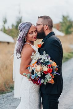 Boho bride and groom with purple hair and lace dress and black suit with orange and blue flowers in this styled shoot in Logan Utah by Krist Alyse Photography. northern utah quality photography meaningful photography wedding and family photographer black suit lace dress purple hair orange purple red blue flowers bohemian wedding #northernutahweddingphotographer #loganutahweddingphotographer #meaningfulphotography #bohowedding #utahweddings #cachevalleyphotographer #bohoweddinginspo…