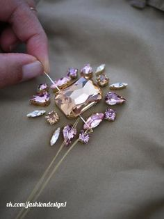 DIY Swarovski Crystal Trenchcoat// This would be so cool on other items & fabrics too!DIY Swarovski Crystal Trenchcoat, I have some broaches I have to do this with!DIY Jeweled Trenchcoat Source by fatmailkerSwarovski Crystals on any plain fabric. Couture Embroidery, Beaded Embroidery, Embroidery Patterns, Hand Embroidery, Bead Embroidery Tutorial, Do It Yourself Mode, Do It Yourself Fashion, Tambour Beading, Motifs Perler
