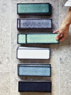 Raku Sapporo In truly jewel-like hues, these Raku tiles have a unique inherent stye like the Japanese ceramic and firing process after which they take their name. The porcelain tile behind is the Neutra in the Greyish colourway. White Bathroom Tiles, Kitchen Tiles, Modern Bathroom, Master Bathroom, Bathroom Trends, Interior Design London, Bathroom Interior Design, Interior Ideas, Glazing Techniques