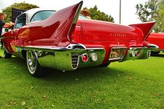 OMG ... my heart be still ... the tail of a red hot 1958 Cadillac Eldorado Brougham.