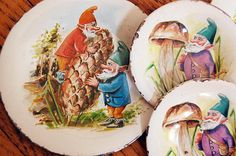 Whimsical Vintage set of toy tin plates with garden gnomes or elves on them with their shovel, acorn and mushroom illustration for child nursery decor. Or these would be a great gift for a gardener!  Set includes 2 large plates and 2 small ones, 4 in total. They are worn along edges.  Large plates measure just under 5 in diameter, small plates 3 1/4 in diameter.  Sale is for all 4.