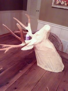 Paper mache deer head.template here http://www.instructables.com/file/F9EXUXBGYKQ5O6M/?size=ORIGINAL
