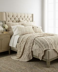 Cozy bed - love the padded headboard & the cable knit blanket.