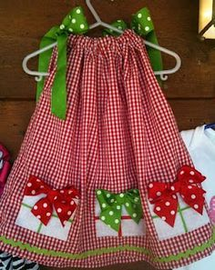 Christmas Pillowcase Dress - too cute. OUR CHURCH MADE THE PILLOWCASE DRESSES FOR DRESSES AROUND THE WORLD.  PRAYING THAT EVERY GIRL CAN HAVE CLOTHES TO WEAR.  IT WAS A REALLY FUN PROJECT. Sewing For Kids, Apron, Pinafore Dress, Aprons