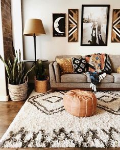 Beautiful boho southwestern style living room. The rust orange color really adds warmth to the room.