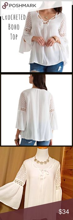 Crochet Sleeve Top Intricate feminine details are everywhere on this beautiful flowy blouse. From the unique lace-up style along the neckline to the crochet design on the sleeve, it is chock full of detail. The fit is figure flattering on most body types. PRICE FIRM UNLESS BUNDLED (retail item). Tops