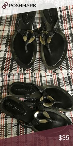 Bandolino Black tribal boho sandals flip-flops Gorgeous features a metal charm and leather or leather feel strap. Very comfortable and durable worn a handful of times still in excellent condition Bandolino Shoes Sandals