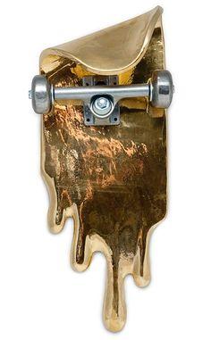 golden dripping skateboard art