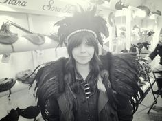 Customer photo - feathered beauty wearing black plume headdress with her own matching collar.  #BlackFeatherHeaddress #FeatherHeadpiece #FestivalHeadwear www.saratiara.com