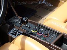 1984 Ferrari Testarossa interior & switches + typical unusual Ferrari R - 1 - 2 gear positioning. So 80's.