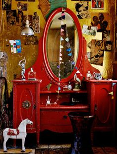 eclectic and fun - now that old dresser is RED this would work perfectly in a bohemian or gypsy chic