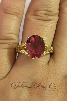 This exuberant mid-19th century style ring showcases a 4.42 carat pink tourmaline. There was a fascination for large faceted gemstones at this time and this ring would have been at home with the elaborate furnishings and dresses of the Victorian era. The beautiful pierced setting is in 18 carat yellow gold. #yellowgoldring #pinktourmalineengagementring #vintagestylerings  #nondiamondengagementring #unusualrings Non Diamond Engagement Rings, Victorian Engagement Rings, Pink Tourmaline Ring, Unusual Rings, Vintage Style Rings, Yellow Gold Rings, Victorian Era, 19th Century, Jewelery