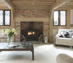 Gorgeous creamy stone fireplace with log burner Log Burner Living Room, Log Burner Fireplace, Cottage Fireplace, Inglenook Fireplace, Fireplace Design, My Living Room, Home And Living, Brick Fireplaces, Modern Fireplaces