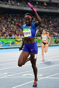USA's Tori Bowie reacts as she crosses the finish line in the Women's 4x100m…