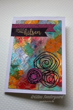 Card made with distress ink, heat embossing, stamps and dienamics