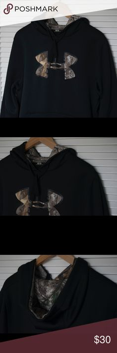 "Under Armour Black and Camouflage Pullover Hoodie Recently purchased and only occasionally worn. This Under Armour Hoodie had no damages or discolorations. Very warm and comes in size medium. The very slightly shiny black body has camouflaged details in the front logo and within the hood. The string within the hood comes out at both sides at about 3.75"". Under Armour Jackets & Coats Lightweight & Shirt Jackets"