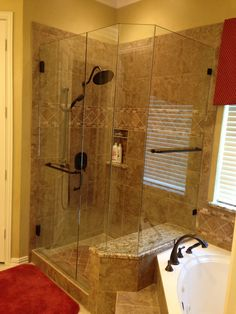 Frameless with door, notched panel, buttress panel, return panel, with mitered corners, and BM 6 x 18 hand/towel combination with Oil Rubbed Bronze hardware finish