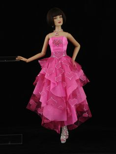 This is a bright pink gown with a multi layered skirt of tule and Glissenette.  Use this pic as inspiration to create something similar or visit my eBay store at http://stores.ebay.com/Inas-La-Petite-Fashion-Promenade eBay id: ina540