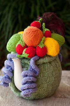 Check out this cool knitted tea cozy of fruit! -- Image only.  Good use for all that amigurumi fruit.
