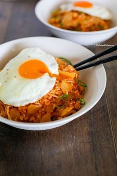 Non-spicy Kimchi fried rice with bacon and enoki mushrooms. It's topped with sunny side up fried egg, sesame seeds, and green onion. | MyKoreanKitchen.com