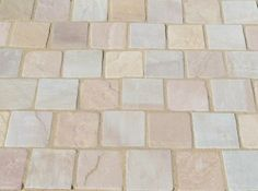 Exclusive to AWBS, these lovely sandstone block paving setts are available in Coastal Mix mix colour which includes pink, grey and sand tones.  These rustic look setts are supplied in 9.98m2 mixed packs which contain 3 sizes of stone sett.  Perfect for patio's, paths and driveways. #SandstoneBlockPaving #AWBSExclusivePaving