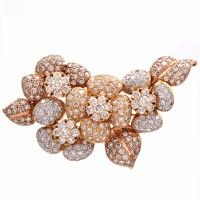 This alluringly estate diamond lapel brooch of unique aesthetics and flexibility is crafted in solid 18K yellow gold, weighing approx: 26.5 grams and measuring approx: 60mm in diameter.  The highly sparkling lapel brooch is completely embellished with round cut diamonds to simulate botanically accurate leaves and flowers.  The precious round cut diamonds weigh cumulatively 6.23cts and are  graded G-H color and VS clarity. The reverse features one with a tubular lock.