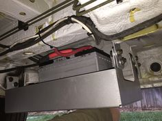 Photo: Battery tray bought from Hein Impact and mounted on driver side of van. Battery is a group 31 AGM from Sam's Club.
