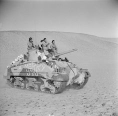 A Sherman tank with a Christmas greeting painted on its hull, Benghazi, 26 December 1942.
