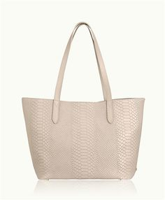 The popular, take-everywhere tote in Full-Grain Embossed Python, features full interior pocket and detachable coin case. Its lightweight feel, generous interior and luxuriously soft handle make it chic yet practical.