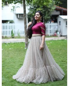 Wine pink crop top with grey tiered skirts lehenga - Indian wedding dress - Indian Fashion Dresses, Indian Gowns Dresses, Dress Indian Style, Indian Designer Outfits, Woman Dresses, Dress Neck Designs, Designs For Dresses, Blouse Designs, Half Saree Designs