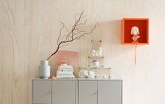 IKEA can help with interior design ideas like a Scandinavian-inspired storage solution with grey metal closed cabinets, found objects on display in plastic boxes and a cubic open cabinet in eye-catching orange. Ikea Interior, Cosy Interior, Interior Design, Studio Interior, Plywood Shelves, Shades Of Light Blue, Open Cabinets, Condo Living, Striped Rug