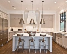 Cool concept for a kitchen!  Love the stainless appliances, metal accents and the beautiful Red Oak hardwood floors!