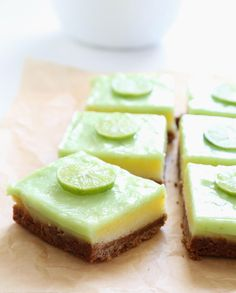 These moist, tender and tangy key lime pie bars have a cookie crumb crust, a custard filling and a simple lime curd topping. Make them days ahead of time, and they'll still taste fresh! http://glutenfreeonashoestring.com/gluten-free-key-lime-pie-bars/