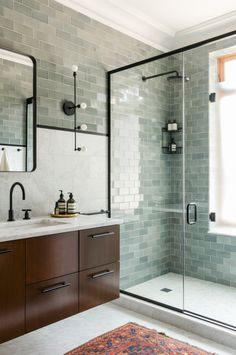 Contemporary bathroom; grey-green and white with black accents. Black fixtures by Jason Wu for Brizo. Designed by Ensemble Architecture.