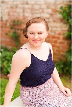 Senior Portrait Photographer in Chesterfield, VA - Natural outdoor photography - senior in blue, floral dress.