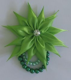 AR souvenir have a nice tutorial for you again. You can make a Beauty Greeny Brooch - D.I.Y Kanzashi Flower. It has bright beauty green colour for satin ribb...